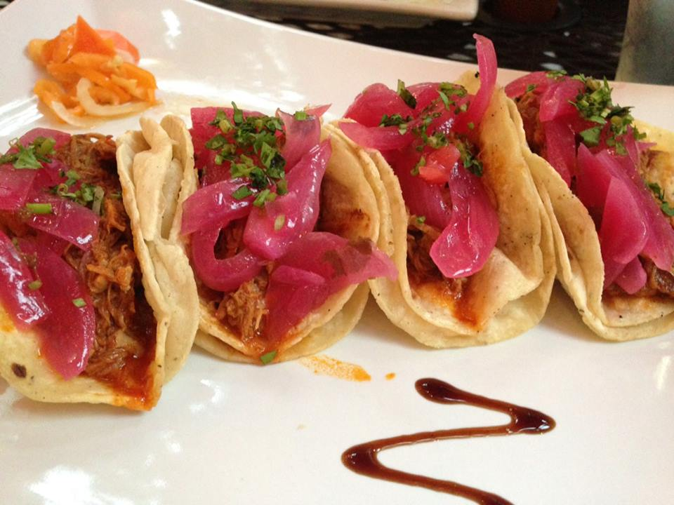 Cochinita pibil tacos await you at New Rebozo in Chicago's Gold Coast.
